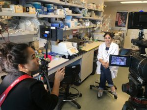 Deborah Manog Dimaya interviews scientist Komal Aurora in the Nichols Lab.