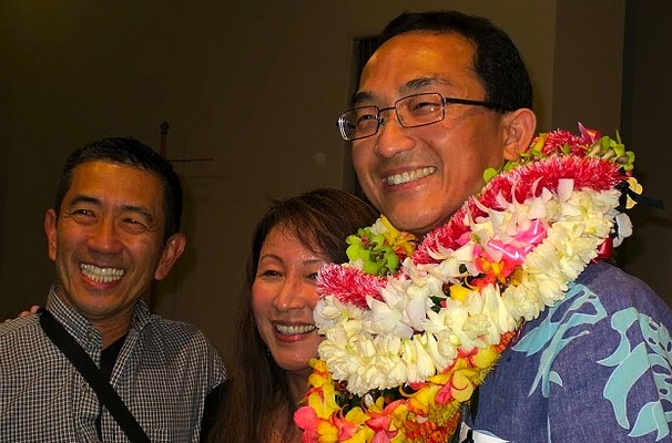 Dr. Dominic Chow covered in lei after receiving a teaching award in 2014.