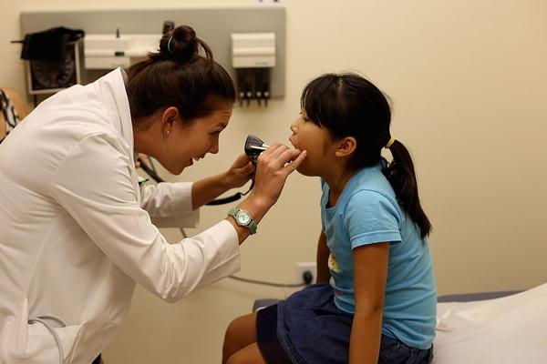Courtney Gaddis examines a child.