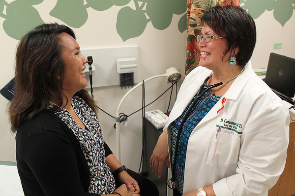 Dr. Carpenter and Vina Cristobal in a clinic.
