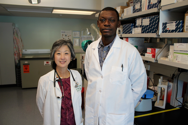 Dr. Cecilia Shikuma, Left, Director of the Hawaiʻi Center for AIDS, with researcher Lishomwa Ndhlovu, MD, PhD