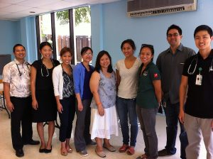 Dr. Omori surrounded by some of the many medical student volunteers who have helped her serve the community through the H.O.M.E. Project.