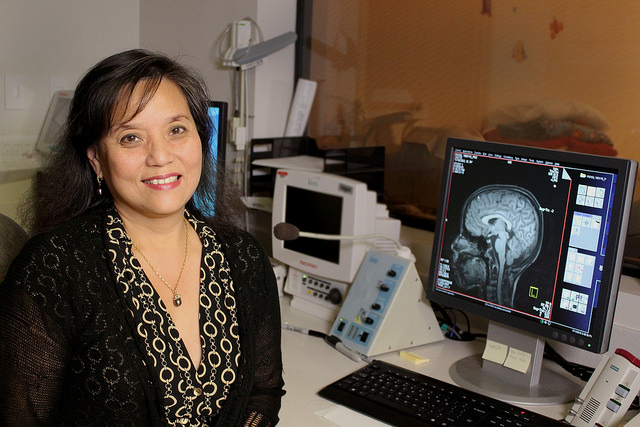 Dr. Chang in the control room of the University of Hawai'i - Queen's Medical Center MR Research Center.