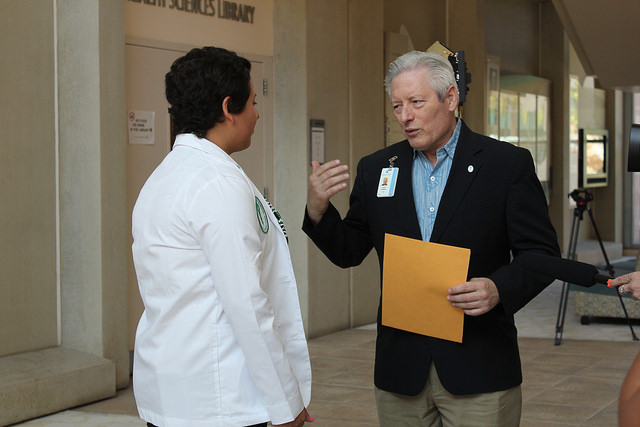 "Dean Jerris Hedges gives Alyssa ""admission for a day"" at the UH medical school."