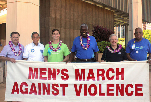 An image of leaders of the Men's March at the State Capitol.