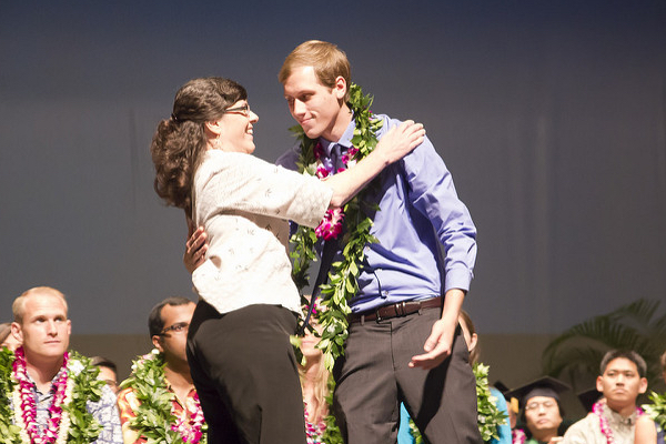 Ryder receives a lei from his mother at the Convocation ceremony in 2014