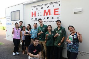 HOME volunteers are pictured outside the mobile clinic van at its stop in Wai?anae.