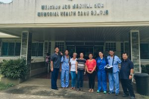 The students are pictured at a clinic in the Philippines.