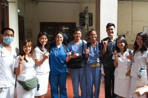 The students are pictured at UT in Manila.