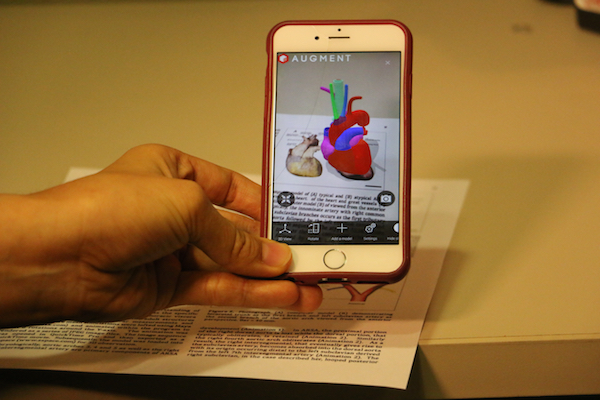"A photo of a cellphone app ""Viewing"" the embedded photo in full 3D."