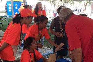 Students are shown helping a patient at the marathon tent