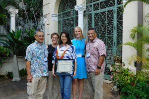 Dr. Melanie Arakaki is pictured in the center.