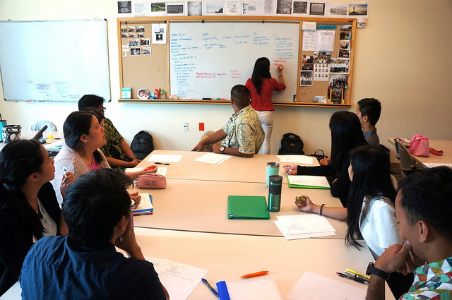 Students work together to discuss the issues in a mock-patient case during problem-based learning.