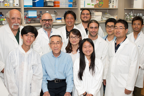 Dr. Yana surrounded by fellow faculty and grad students in the IBR.