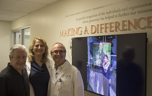 doctors in front of donor wall.