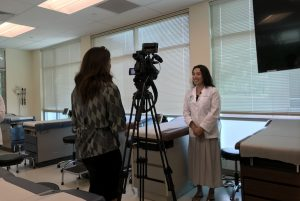 Medical student Maiya Smith is interviewed by reporter Eliza Larson for KITV.
