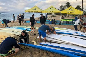 Students are shown getting the surfing gear ready.