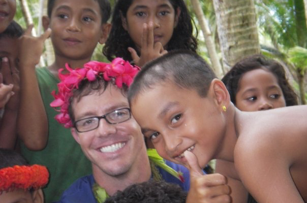 Dr. Hancock on Piig Island in Yap State surrounded by children he served as a family physician