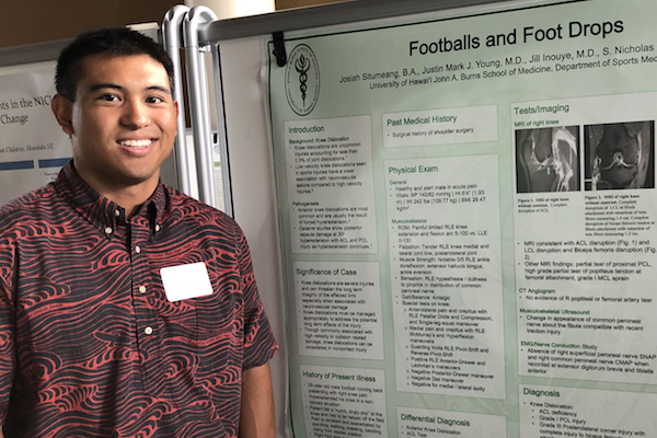 Josiah Situmeang, 1st place winner in the MD Student Division, with his poster.
