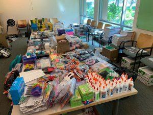 Random school supplies including glue, crayons, notebooks, etc.