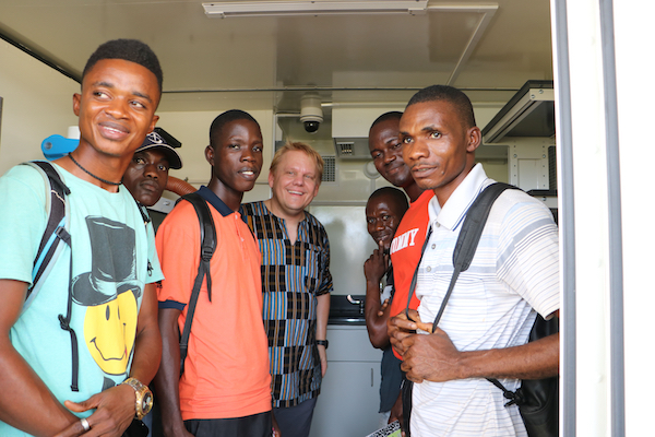 University of Liberia Students pose with University of Hawaii Dr. Lehrer inside one of the mobile laboratories delivered to Liberia.
