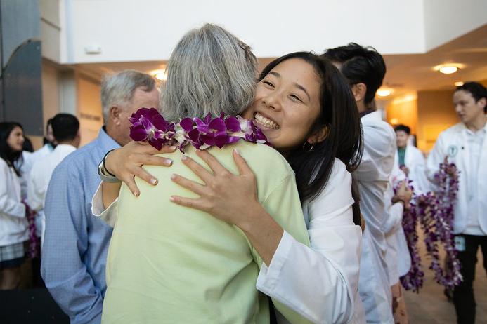 Rylie Wada hugs a scholarship donor
